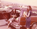 Danette & Kristy in the station wagon.  (Check out all the wagons in the parking lot.  The van too and even a Pinto!)